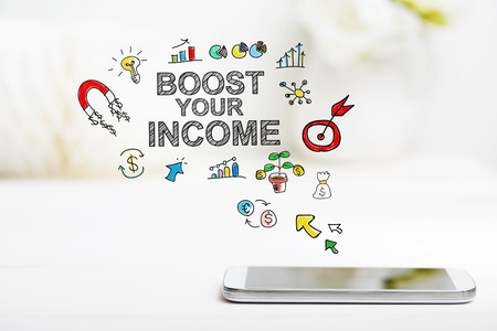 boost: Boost Your Income concept with smartphone on white table Stock Photo