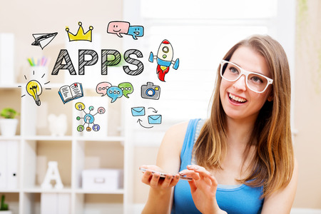 woman smartphone: Apps concept with young woman wearing white glasses using her smartphone in her home