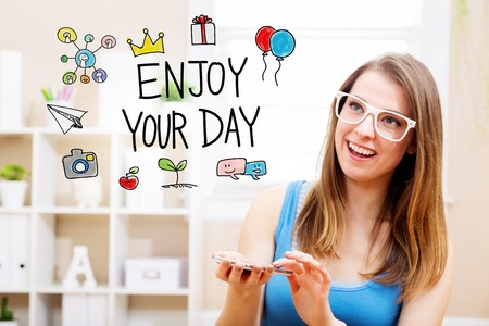 woman smartphone: Enjoy your day concept with young woman wearing white glasses using her smartphone in her home