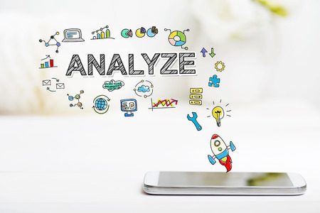 analyze: Analyze concept with smartphone on white table Stock Photo