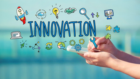 Innovation concept with person holding a smartphone Stock Photo