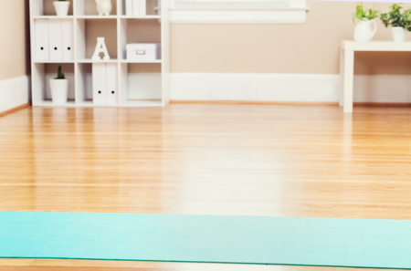 Yoga mat in an empty home studio Stock Photo