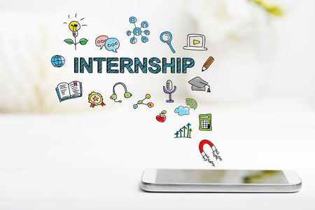 Internship concept with smartphone on white table Stock Photo