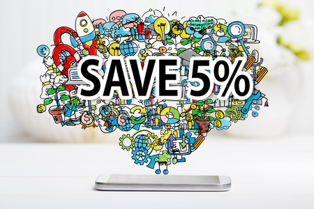 sale tag: Save 5 percent text with smartphone on white table