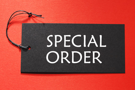 bespoke: Special Order text on a black tag on a red paper background