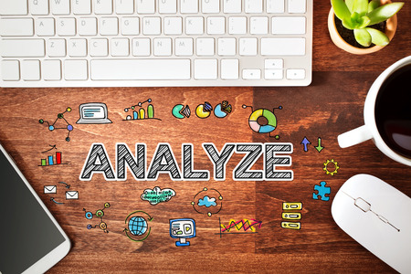 analyze: Analyze concept with workstation on a wooden desk Stock Photo
