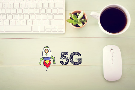 5g: 5G concept concept with workstation on a light green wooden desk
