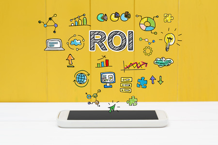 ROI concept with smartphone on yellow wooden background