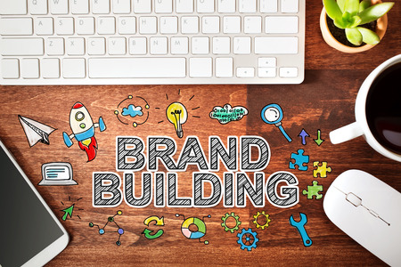 brands: Brand Building concept with workstation on a wooden desk