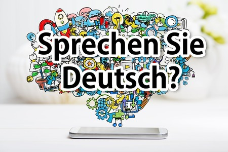 deutsch: Sprechen Sie Deutsch message with smartphone on white table