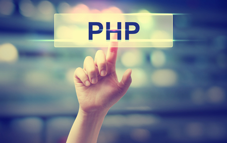 php: PHP concept with hand pressing a button on blurred abstract background Stock Photo