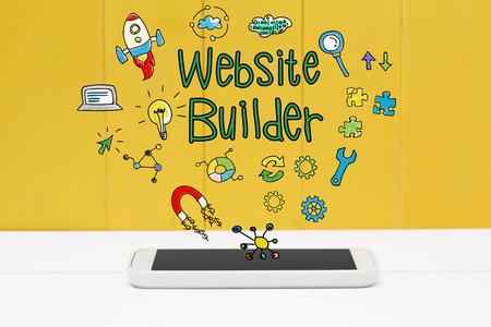 schöpfung: Website Builder-Konzept mit Smartphone auf gelbem Holzuntergrund