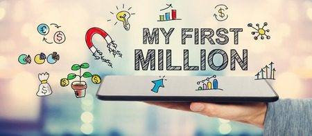 MILLION: My first Million concept with man holding a tablet computer