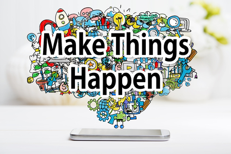 inspiration: Make Things Happen concept with smartphone on white table Stock Photo