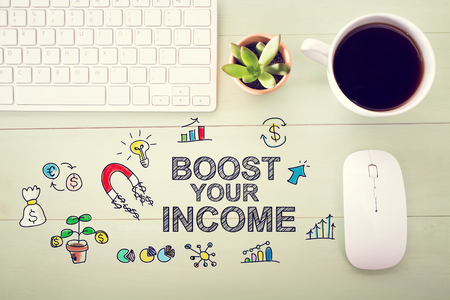 desk light: Boost Your Income concept with workstation on a light green wooden desk Stock Photo