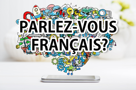 Parlez vous Francais concept with smartphone on white table