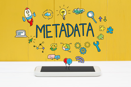 meta: Meta Data concept with smartphone on yellow wooden background