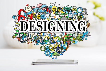 designing: Designing concept with smartphone on white table