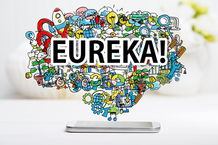 eureka: Eureka concept with smartphone on white table
