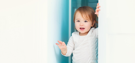 Panoramic portrait of a happy toddler girl inside Stock Photo