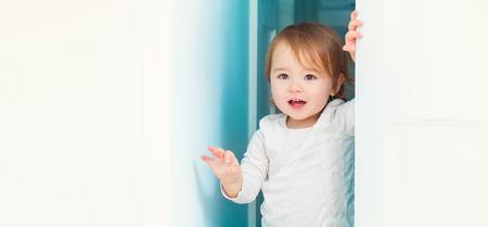 Panoramic portrait of a happy toddler girl inside Foto de archivo