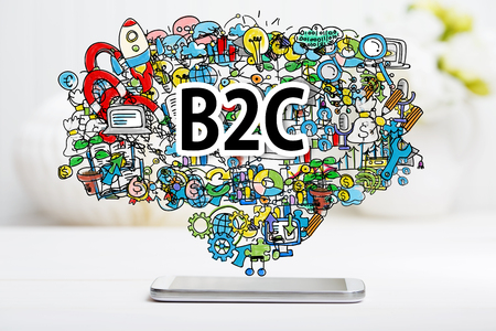 b2c: B2C concept with smartphone on white table
