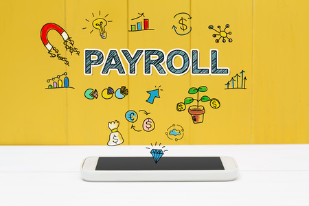 payroll: Payroll concept with smartphone on yellow wooden background Stock Photo
