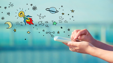 Idear Rocket concept with person holding a smartphone Stock Photo