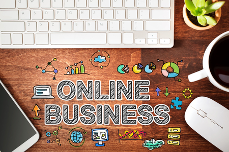 small business computer: Online Business concept with workstation on a wooden desk Stock Photo