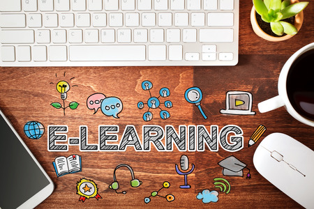 elearning: Elearning concept with workstation on a wooden desk