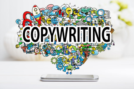 copywriter: Copywriting concept with smartphone on white table