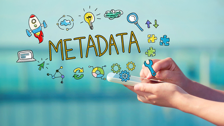 metadata: Metadata concept with person holding a smartphone