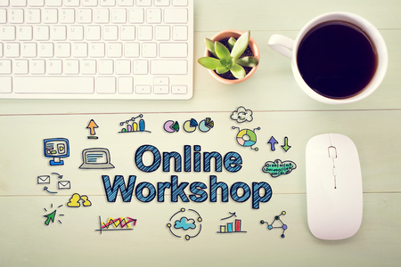 workshop seminar: Online workshop concept with workstation on a light green wooden desk