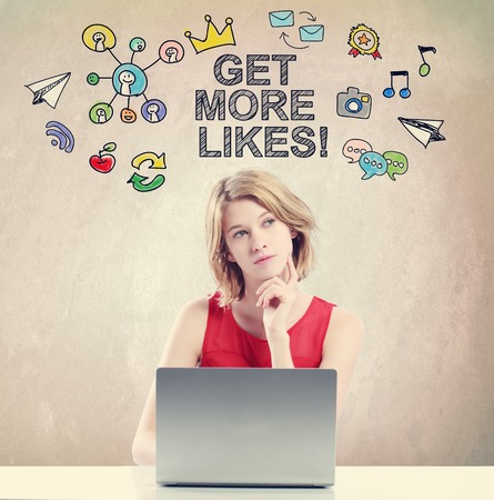 woman laptop: Get More Likes  concept with young woman working on a laptop