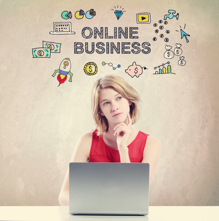 online business: Online Business concept with young woman working on a laptop Stock Photo