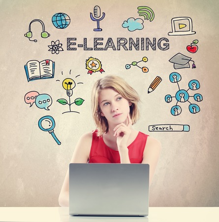 e learn: E-learning concept with young woman working on a laptop