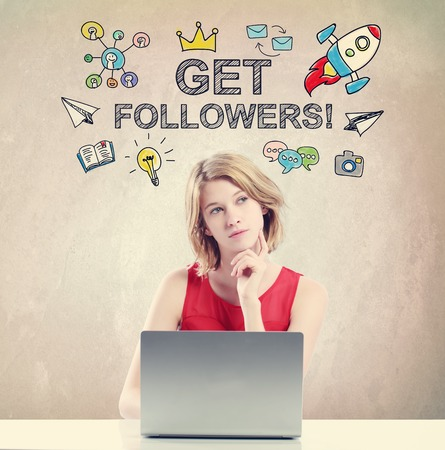 woman laptop: Get Followers concept with young woman working on a laptop