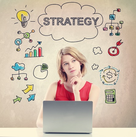 Strategy concept with young woman working on a laptop