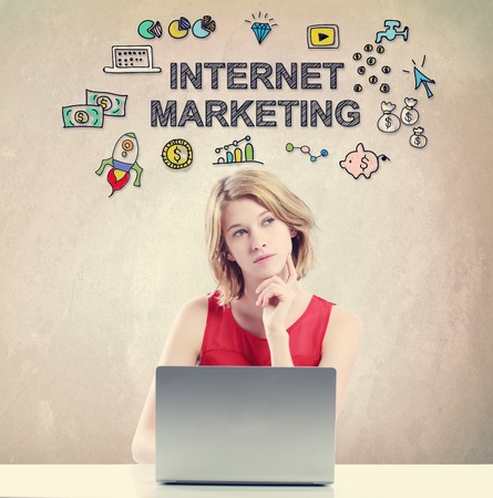woman laptop: Internet Marketing concept with young woman working on a laptop