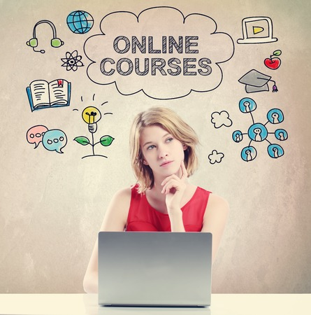 online business: Online Courses  concept with young woman working on a laptop