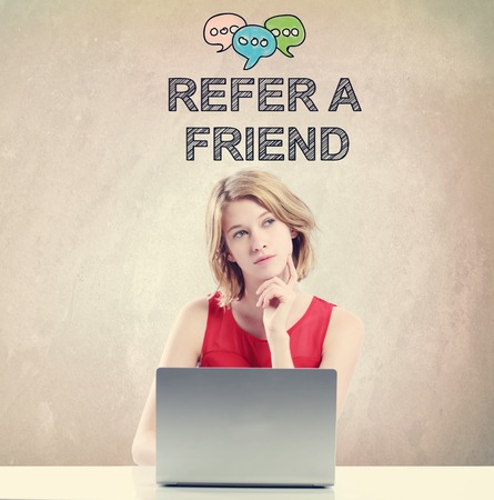 Refer A Friend concept with young woman working on a laptop