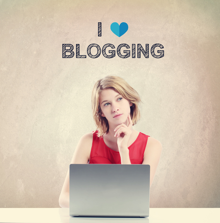 girl illustration: I Love Blogging concept with young woman working on a laptop Stock Photo