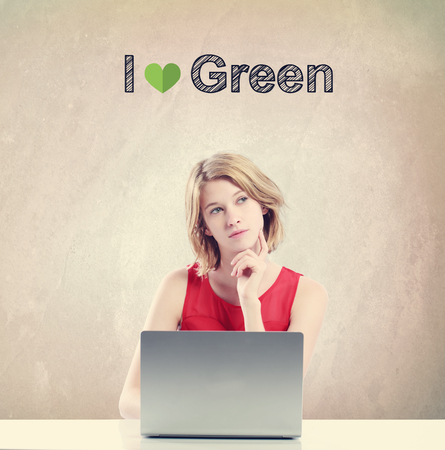 woman in love: I Love Green concept with young woman working on a laptop Stock Photo