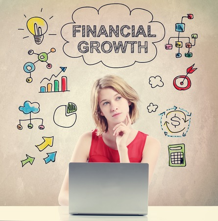 mujer pensando: Financial Growth concept with young woman working on a laptop