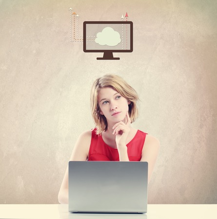 woman laptop: Cloud Computing concept with young woman working on a laptop