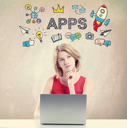 APPS concept with young woman working on a laptop