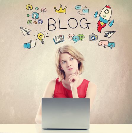 business woman: Blog concept with young woman working on a laptop