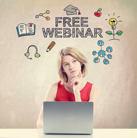 woman laptop: Free Webinar concept with young woman working on a laptop Stock Photo