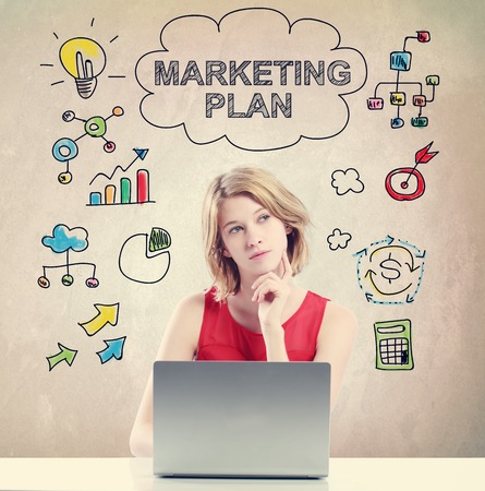 girl laptop: Marketing Plan concept with young woman working on a laptop