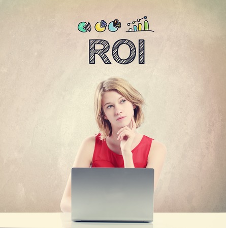ROI concept with young woman working on a laptop